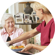 caregiver serving meal